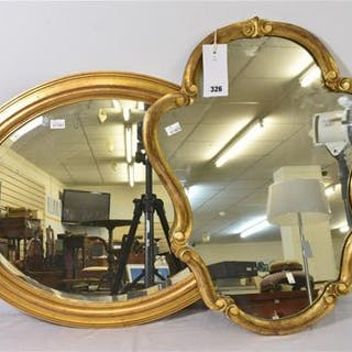 An antique oval giltwood mirror with bevelled plate, together with