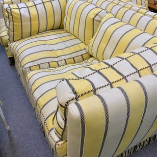 A Knowle style sofa with matching footstool in a striped pale yellow