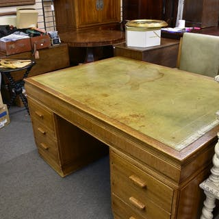 An Art Deco oak desk with leather top and matching leather chair.