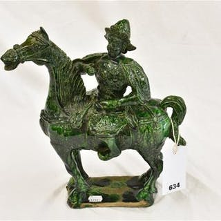 A Chinese green glazed terracotta warrior on a horse (head repaired).