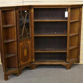 An Edwardian mahogany and satinwood cross banded glazed corner low bookcase