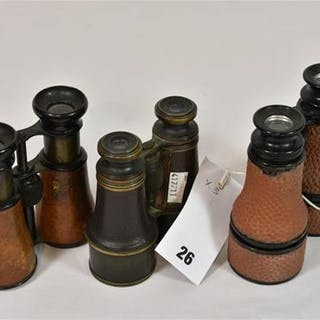 Three pairs of early 20th century military binoculars to include a