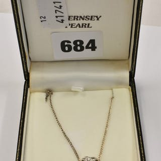 A silver, freshwater pearl and diamond pendant necklace, on silver chain.