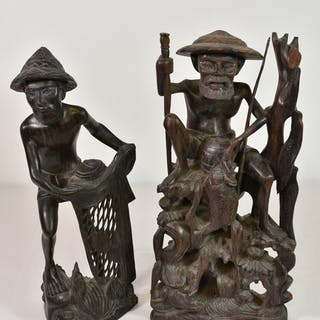 Two carved wooden Japanese fishermen