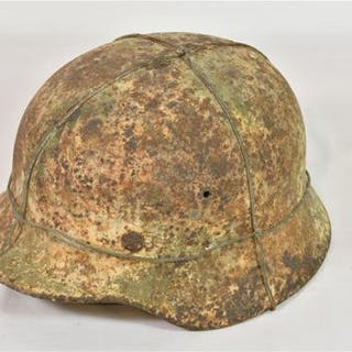 A WW2 German M40 steel helmet and liner, no chin strap, appears overpainted