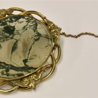 A Victorian rolled gold and moss agate brooch
