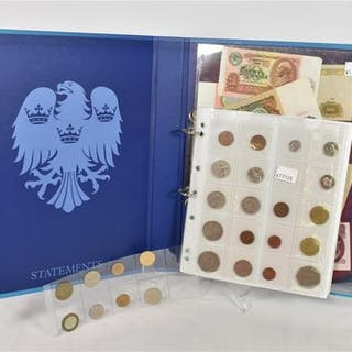 A collection of various world notes and coins.