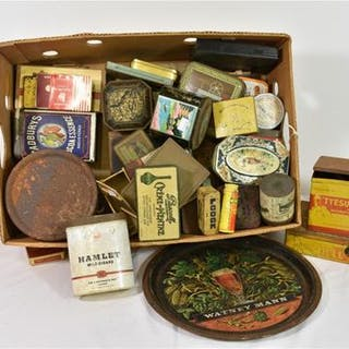 A large collection of various advertising tins and boxes to include