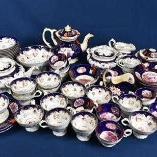A 19th century English porcelain part tea service decorated with a