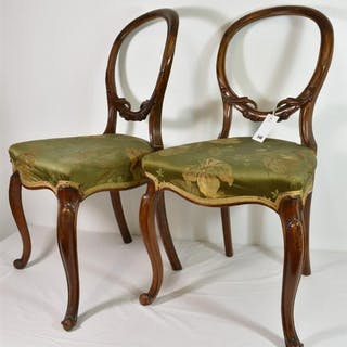 A pair of Victorian walnut balloon back chairs