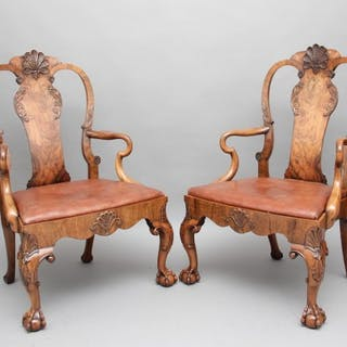 A pair of early 20th Century walnut open armchairs