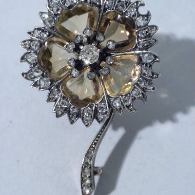 Sale Price: This pretty brooch with stones mounted in...