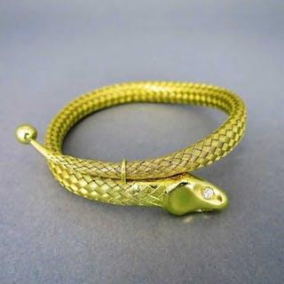 Exklusiver Schlangen Armreif in 750/-Gold geflochten mit Brillant-Augen