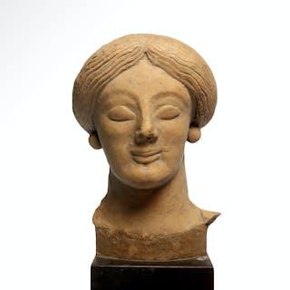 Greek Archaic Terracotta Head of a Lady, c. 600 - 500 B.C.