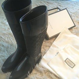 Gucci Boots – Current sales – Barnebys.com 118451a8fc79