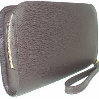 052a9fb0068 Louis Vuitton - Burgundy Taiga Leather Baikel Pochette Bag – Current sales  – Barnebys.com