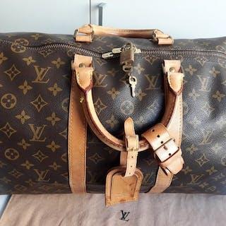 ... Louis Vuitton - Boston Keepall 55 with Padlock Duffle bag. Closed  auction 8415c6ec234