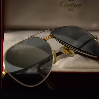 5dacb6505b617 Cartier Sunglasses – Current sales – Barnebys.com