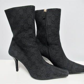 98c5fdd9149 Gucci Boots – Current sales – Barnebys.com