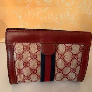 8051bb1838f5 Gucci - Rara trousse pochette rosso e blu monogram anni 70 Clutch bag –  Current sales – Barnebys.com