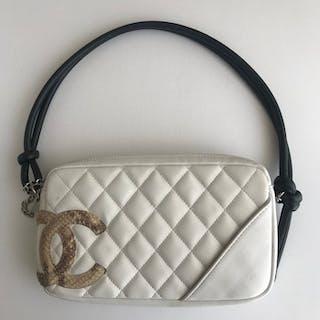 5dcdf941aca852 Chanel - Cambon CC Python Pochette Handbag – Current sales – Barnebys.com