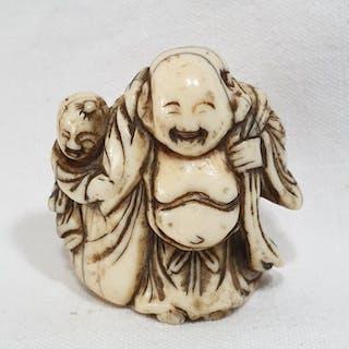 Netsuke (1) - Elephant ivory - Hotei with karako - Japan...