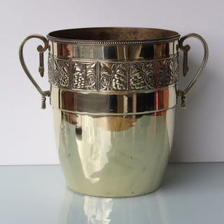 Art Nouveau brass champagne wine cooler.