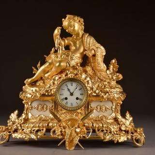 Impressive bronze mantle clock with a romantic image of a...