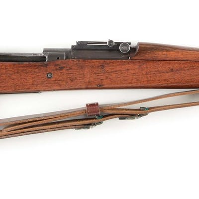 The barrel and action were built in 1933 and rifle...