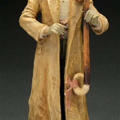 Gentleman in a long coat holding a cane