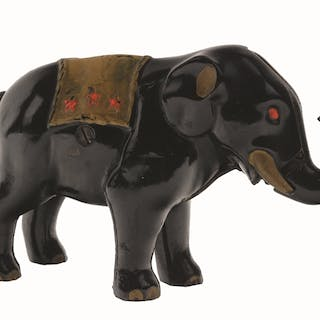 Place a coin in the end of the elephant's trunk and press the tail