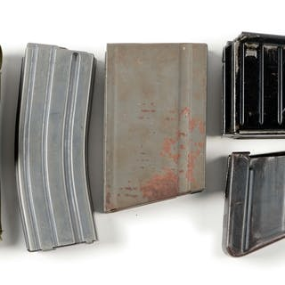 Lot consists of: two 25 round Uzi magazines in a green...