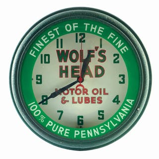 An excellent example of this Neon Clock for Wolf's Head Motor Oil