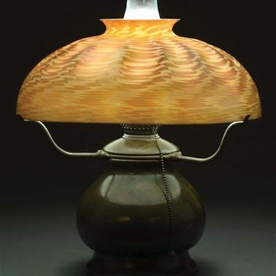 Tiffany Studios table lamp has a large gold Damascene shade