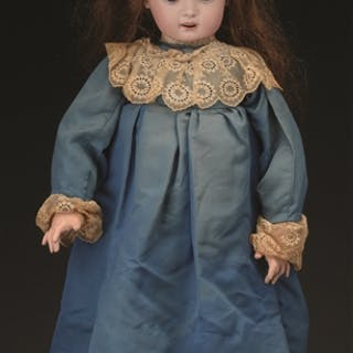 "This 26"" (66cm) bisque socket head doll is incised simply ""11"""