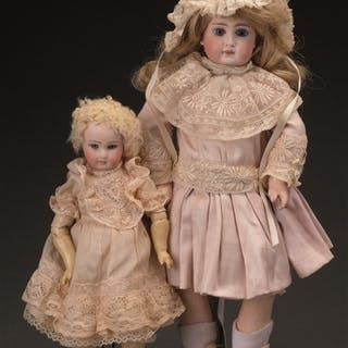 Lot consists of: The larger doll