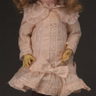 This closed mouth bisque socket head doll has the head...