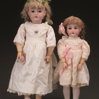 Lot consists of: The larger of the two dolls