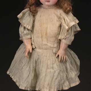 "This 24"" (61cm) 1890's era doll was originally marketed as ""Bebe Premier Pas"""