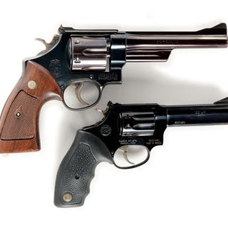 Lot consists of: (A) Smith & Wesson Model 28 six shot...
