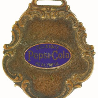 The logo is enameled in blue on top of a copper and brass background