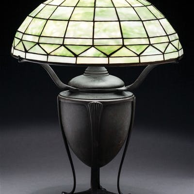 Tiffany Studios table lamp has leaded glass shade in the...