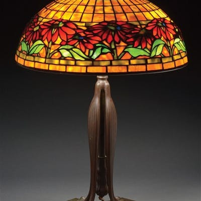 Tiffany Studios table lamp has a wide band of red...