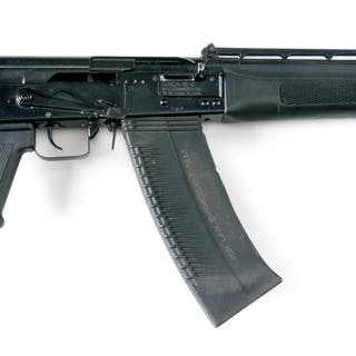 Offered is a military style box magazine fed semi-automatic shotgun