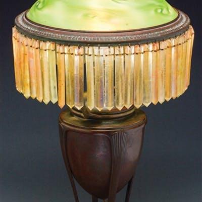 Tiffany Studios table lamp has bronze Grecian urn base...