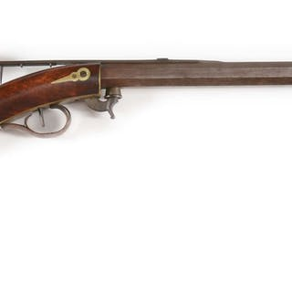 This diminutive rifle features an octagon barrel with brass muzzle protector