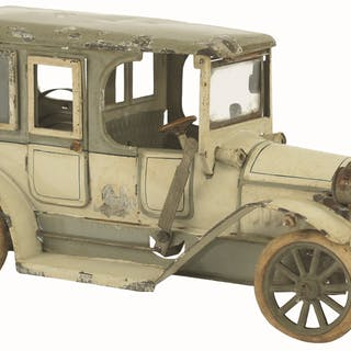 Cream color sedan with grey roof and original rubber tires