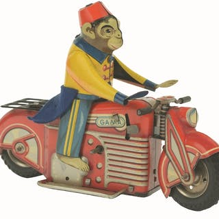 """Tin-Litho wind-up toy is marked """"GAMA"""" on both sides and..."""