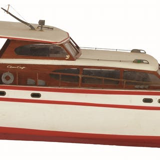 Chris-Craft Boat has portion of wooden railing broken on rear