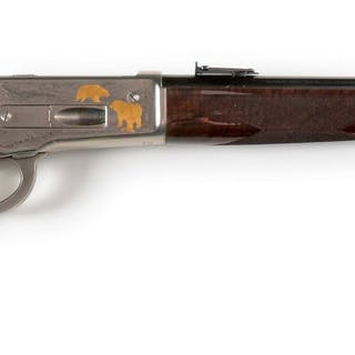 Browning saddle ring carbine featuring nickel frame and lever